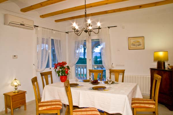 Comfortable indoor dining area with access to terrace and swimming pool